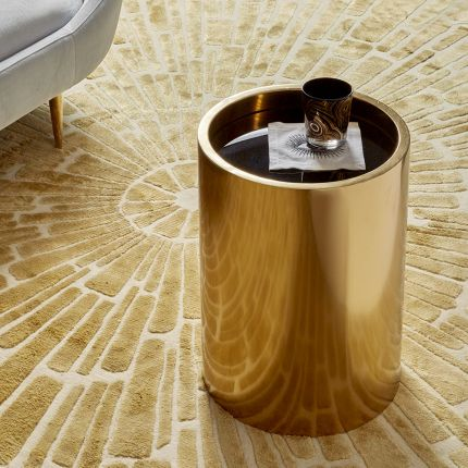 polished brass accent table with black glass  top