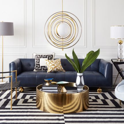 round brass coffee table with smoke mirror top