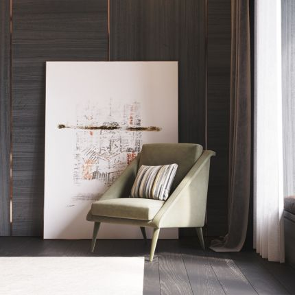 A luxurious angular mid-century-inspired armchair with sloped armrest and upholstered legs. Pictured in Vienna Mud.