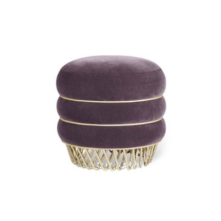 A Hollywood glamour inspired stool with a luxurious velvet upholstery, golden piping and polished brass finish