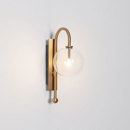 Natural solid brass industrial wall lamp with large handblown glass globe