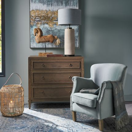 A stylish minimalist oak and plywood three drawer chest of drawers with brass handles
