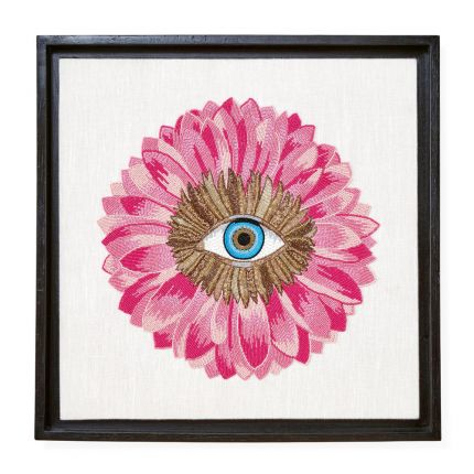 Pink petals and blue eye wall art in black frame by Jonathan Adler