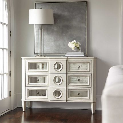 A luxury white oak veneer chest of drawers accentuated by antiqued mirrored glass panels with Silver Luster highlights and a Manor White finish