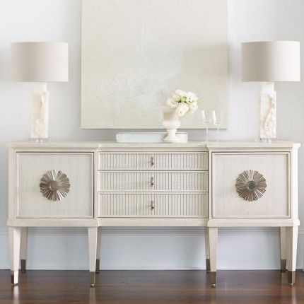 An exquisite sideboard with an elegant white finish, stunning silver highlights and floral inspired features