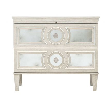 An elegant white oak veneer bedside table with two antiqued mirrored glass panel drawers, Silver Luster highlights and a Manor White finish