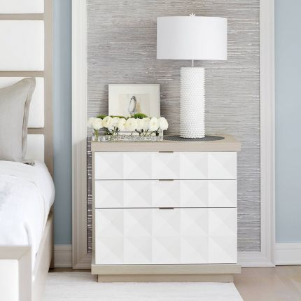 A unique three drawer geometric patterned bedside table with a white and grey finish