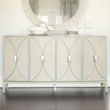 A stylish buffet with four curved silver metal framed overlaid doors and ample internal storage