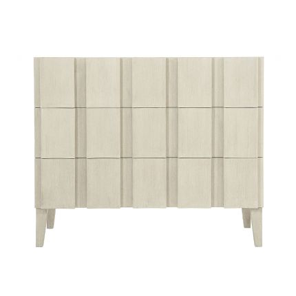 A unique three drawer chest by Bernhardt with shaped vertical overlays and a beautiful natural aged wood finish