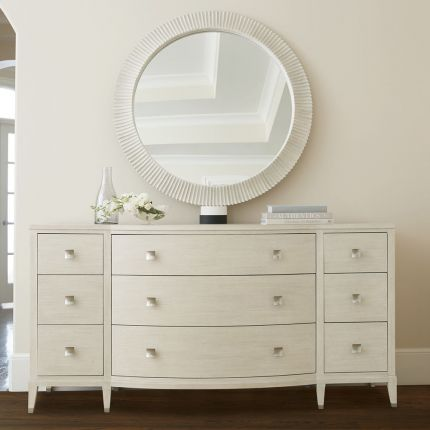 A gorgeous dresser from Bernhardt with a natural finish, tarnished nickel accents and nine drawers