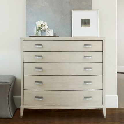 A beautiful chest of drawers from Bernhardt with five drawers and tarnished nickel handles