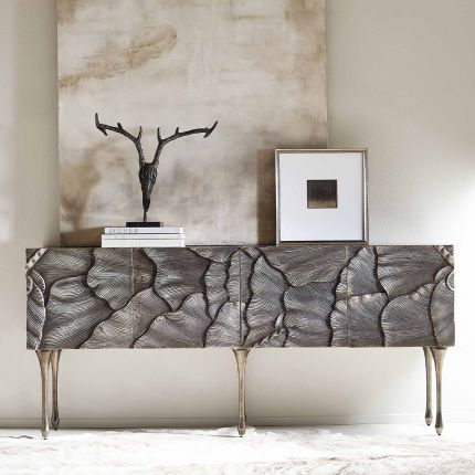 A textured statement sideboard with four unique doors, six sleek metal legs and an abundance of internal storage