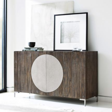 A beautiful dark brown wooden cabinet with two doors, a circular steel overlay, interior drawers and shelving