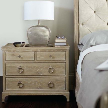 A 4 drawer bedside table in a sand finish