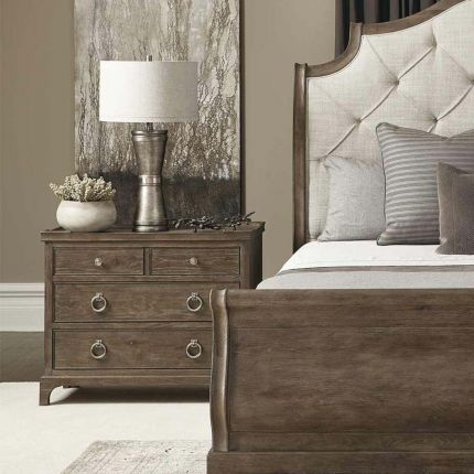 A dark featured bedside table with four drawers