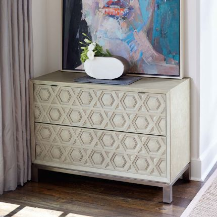 A unique two drawer chest of drawers from Bernhardt with a textured geometric design and stainless steel base with a nickel finish
