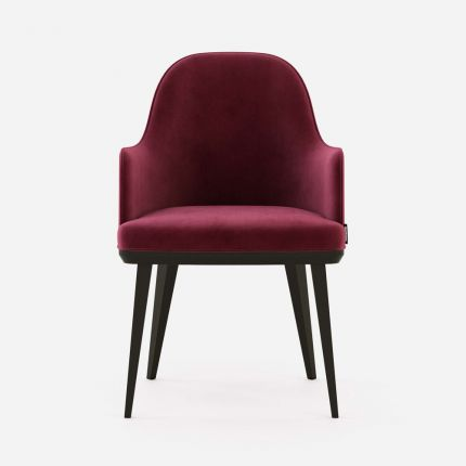 Rich velvet upholstered dining chair with arms and dark black oak legs