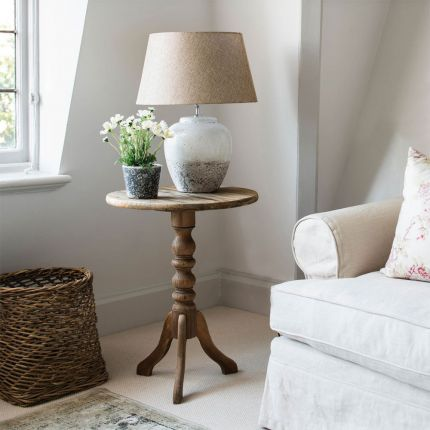 A costal, cottage-inspired table lamp with a natural linen shade