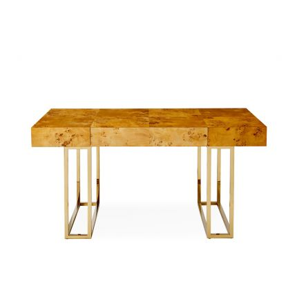A classic burled mappa desk with a polished brass base