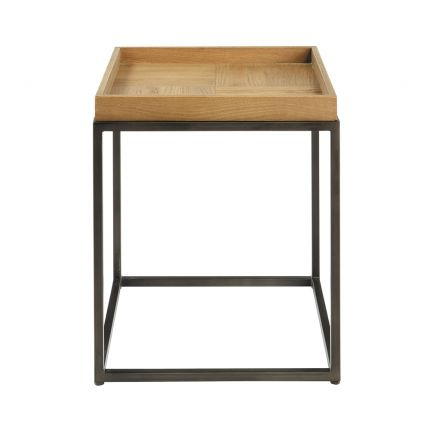 A chic industrial-style iron and wood side table