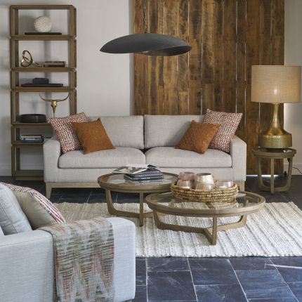 A luxurious modern cosy sofa with beige upholstery