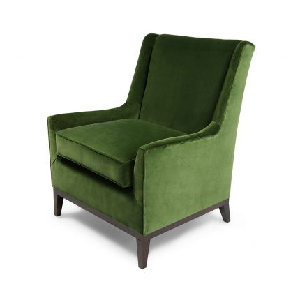 A gorgeous armchair with a wooden base and mid-century undertones