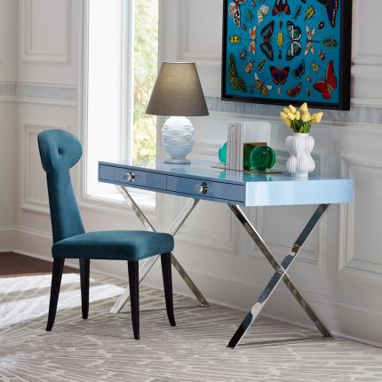 A glamorous ice blue desk with nickel hardware and acrylic handles