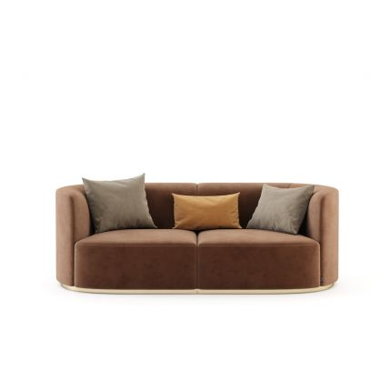 a sensational two-seater sofa with a golden base and luxurious velvet upholstery