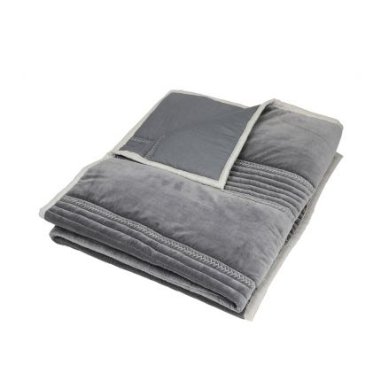 A luxurious grey quilt with handstitched details