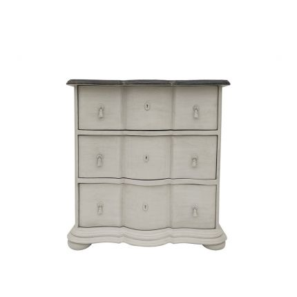 A luxurious putty-toned distressed French-style chest of drawers