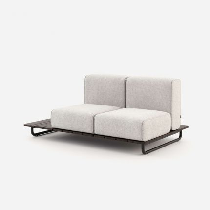 A stylish outdoor sofa upholstered in a natural-toned fabric on a painted steel base