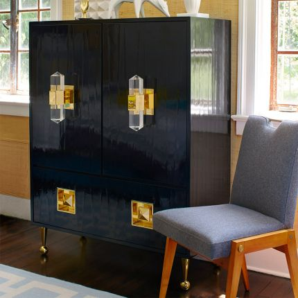 A luxurious, contemporary cabinet with glossy black lacquer and acrylic and brass accents