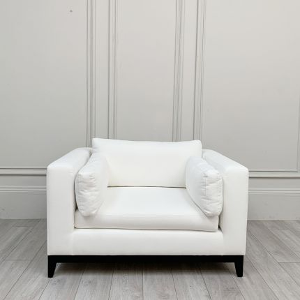 A Love Seat with clean-cut lines, sumptuous upholstery and two rectangular feather-filled cushions