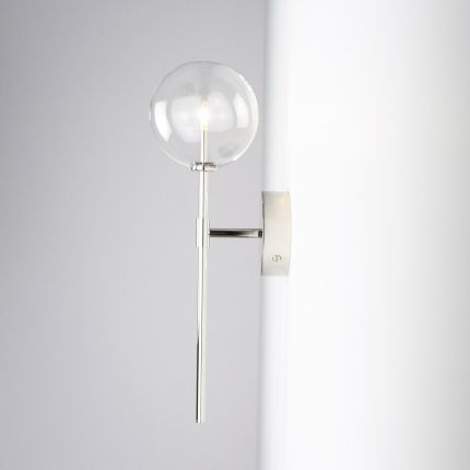 Contemporary industrial wall lamp in polished nickel finish with a large clear glass sphere lampshade