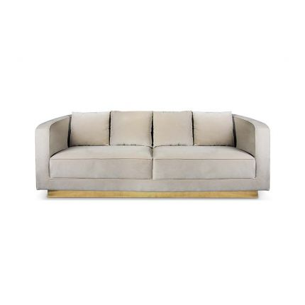 A sensational sofa with a luxurious upholstery and polished brass base