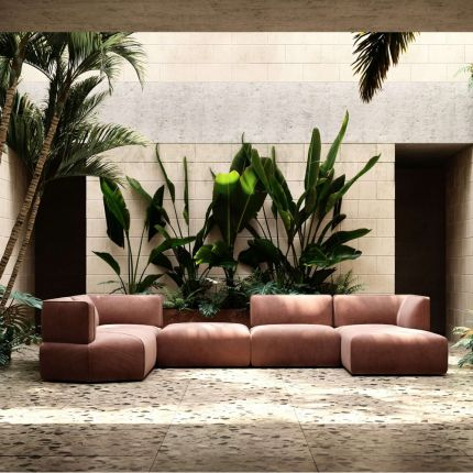Luxury, large sofa upholstered in pink velvet, with curvy, contemporary design