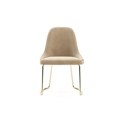 A luxurious natural-toned velvet dining chair with gold polished stainless steel legs