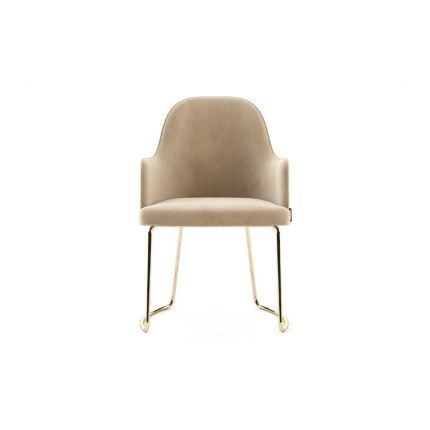A luxurious, velvet dining armchair with gold polished stainless steel legs