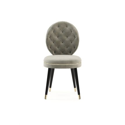 Deep buttoned Parisian dining chair with dark legs and golden accents
