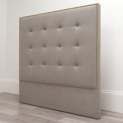 Glam gold studded headboard with buttoned detailing