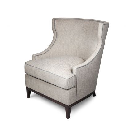A traditional armchair with a wing-back design and a wooden base