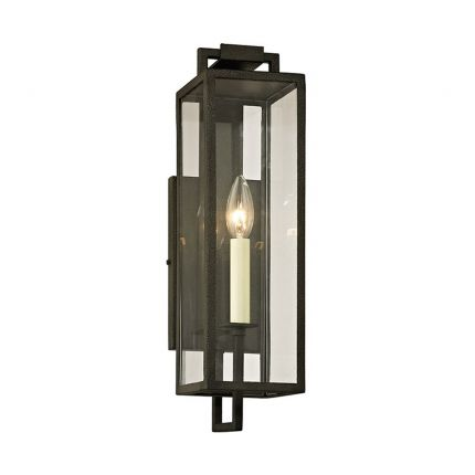 A chic black iron and clear glass wall lantern