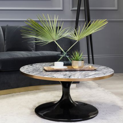 a round marble top table with gold rim and sloped black base