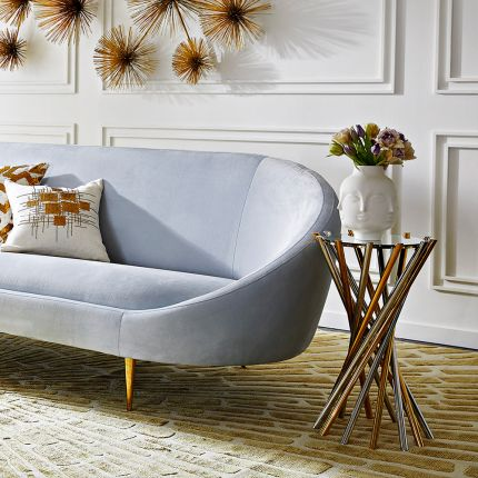 a glamorous nickel and brass table with a mirrored surface