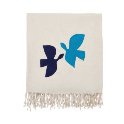 A luxurious ivory throw with blue birds