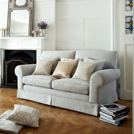 Luxury designer sofa with high back cushion and fitted skirt