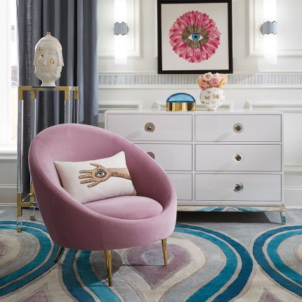 A stylish lavender armchair with polished brass legs