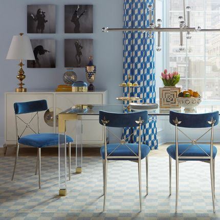 A stylish acrylic and brushed brass dining table