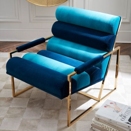 A glamorous two-toned blue velvet lounge chair