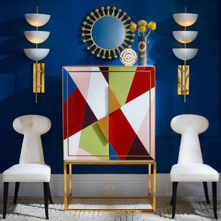 A luxurious geometric multicoloured bar drinks cabinet with brass accents